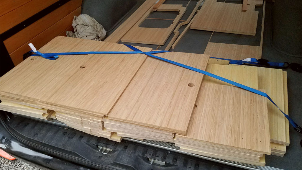 CAD designed, router cut, bamboo laminate cabinet pieces for Sprinter Van conversion