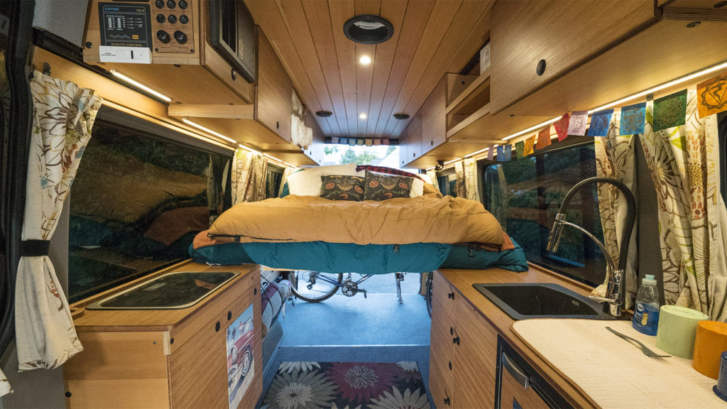CreatID custom sprinter conversion kitchen cabinets with versatile abundant space for people, bikes, and gear