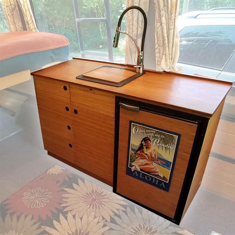 Sprinter van kitchen cabinets - warm wood, elegant, and compact